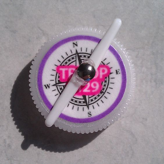 Compass plastic water bottles and forks on pinterest for Water bottle cap crafts