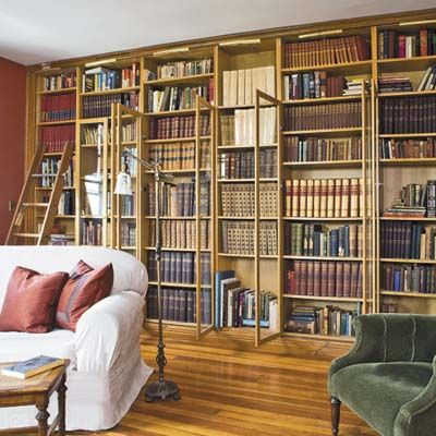 IKEA bookshelves made to look built-in with molding and doors.