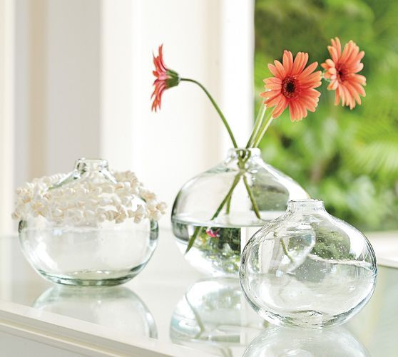 put one at each place setting with single white ranunculus in it? or sweet pea?  Eleana Recycled Glass Bud Vases, Set of 3 | Pottery Barn