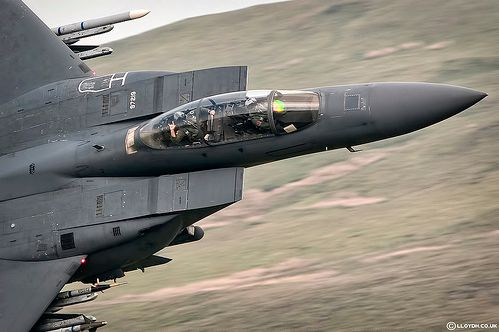 Photog Lloyd Horgan gets the devil horns from this F-15E Weapon Systems Officer (WSO) as he and his pilot blast through the Mach Loop.