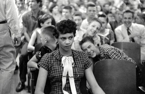 This is a photo of Dorothy Counts being jeered and taunted by her white, male peers.