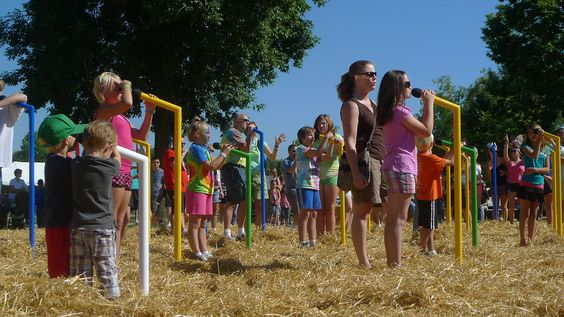 Giant Sing Along. A field of 32 microphones welcomes participants to sing their hearts out, karaoke style, celebrating the magic of singing ...