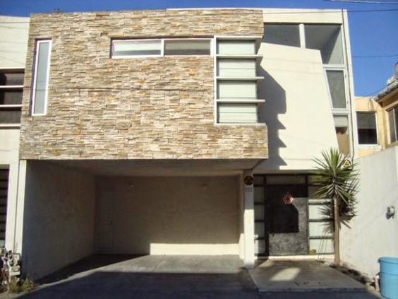 Resultado de imagen para Casa moderna con garaje abierto y revestimiento de piedra