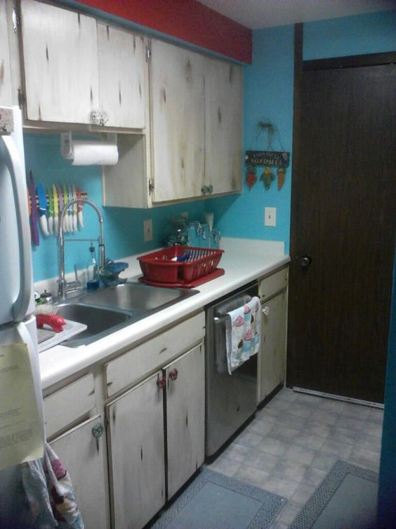 Our rental alley kitchen after. Teal & red with distressed cabinet doors.