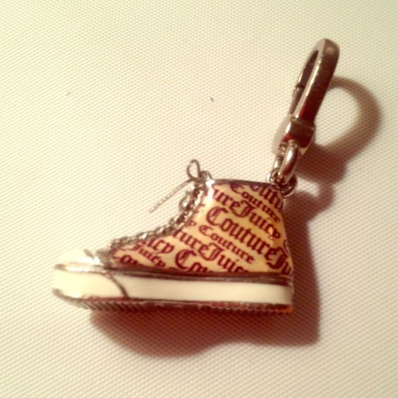 Juicy couture charm Silver tone juicy couture gym shoe charm. Really pretty. Juicy Couture Jewelry