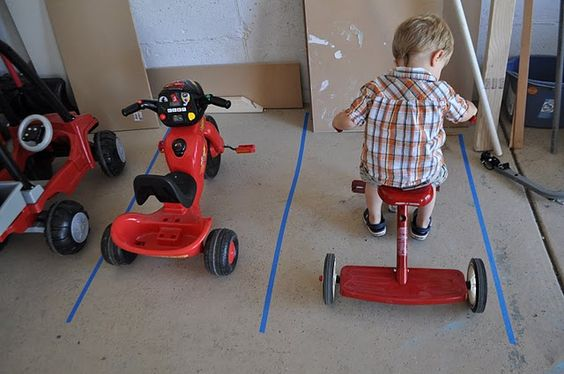 "make ""parking spaces"" for your kids' outside toys (helps them to put things back in an appropriate space)."