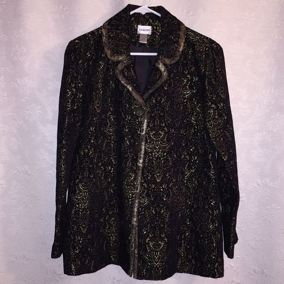 Chico's Black and Gold Jacket Chico's Black and Gold Jacket. Never worn. Chico's size 1 (8/10). Fully lined. 2 buttons down the front. 2 front pockets (still sewn shut). The jacket has a velvet look to it. Simply gorgeous! 59% Rayon, 35% Polyester, 4% Cotton, 2% Other Fibers. Chico's Jackets & Coats Blazers