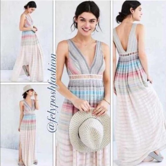 Urban Outfitters Ecote Sanibel Rainbow Maxi Dress Urban Outfitters Ecote Sanibel Rainbow Maxi Dress Airy sleeveless maxi dress from Ecote in a unique mix-stitched rainbow gauze fabric we love. Cut with a v-neck front and back trimmed with lattice detailing along the empire waist. Zip closure; fully lined.  Content + Care - Rayon  - Machine wash  - Imported Urban Outfitters Dresses Maxi