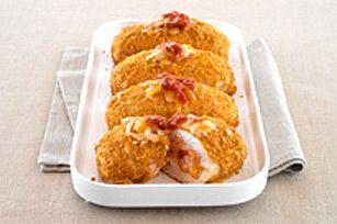 Il est temps de réinventer votre poulet au four: enrobez-le d'une panure croquante et garnissez-le de fromage Tex Mex râpé et de salsa rustique. Un plat véritablement extraordinaire!