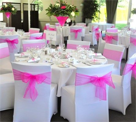 Stretch fitted chair covers with fuschia pink organza bow - Fuschia
