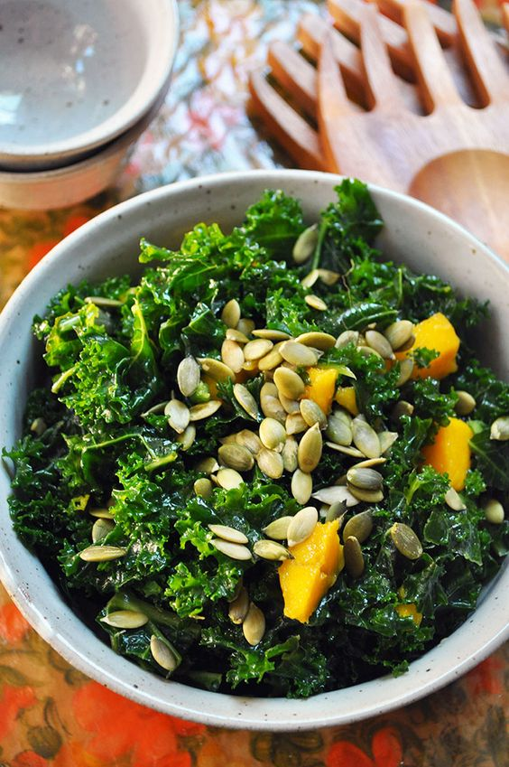 Superfood Kale and sweet mango combine perfectly with roasted pumpkin seeds to create a colorful and delicious salad!