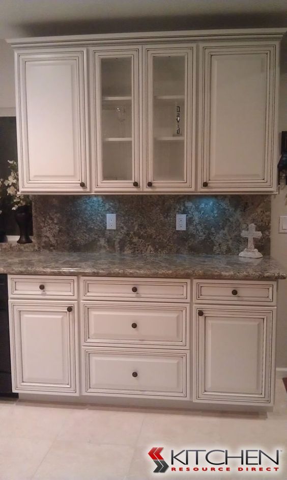 Small sink plumbing and trim work on pinterest for Antique white kitchen cabinets with chocolate glaze