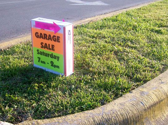 Make Weighted Wind Proof Garage Sale Signs ...place brick inside box