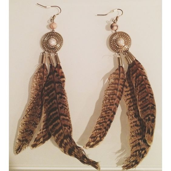 Brown Feather Earrings Brown feather earrings with a brass/goldish base and a stone detail. Jewelry Earrings