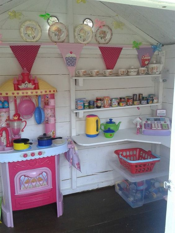 Inside of Erin and Leah's wooden playhouse as always the clever husband built it and I got to paint it and make it pretty.