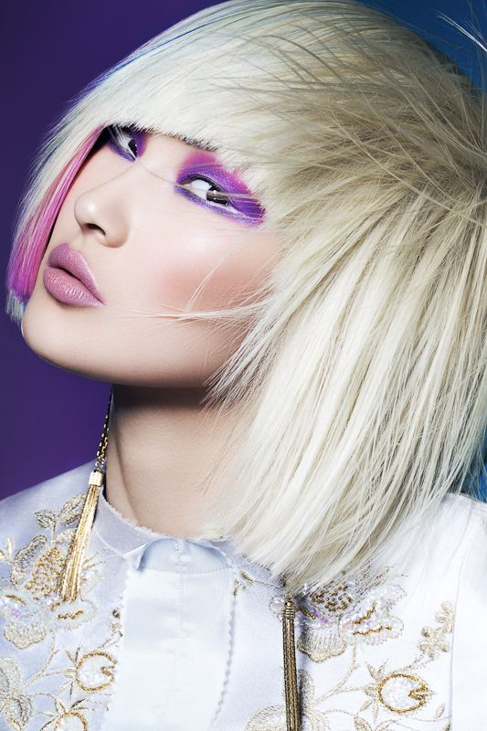 Beautiful asian girl w/ platinum hair and purple make