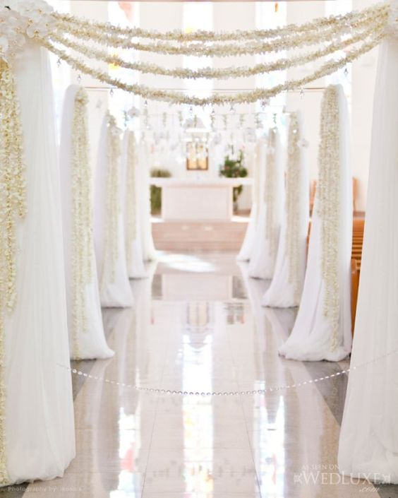 indoor wedding ceremony elegant arch decorations inspiration