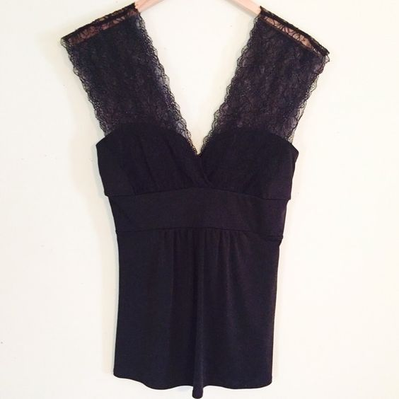 Like New Sexy Black Lace Stretch Top Like new. Very sexy yet classy at the same time. Dress it up for a night out or dress it down with a cardigan for work! Perfect amount of stretch & lots of comfort. 92% polyester 8% spandex Tops