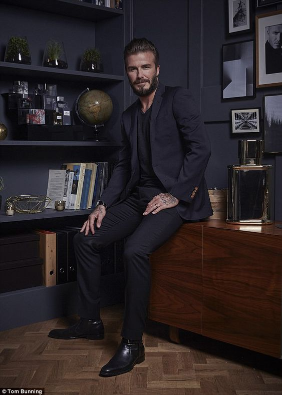 Fragrance king: David Beckham posed with a new limited edition take on his debut mens fragrance Instinct on Thursday, to celebrate ten years since he released the scent
