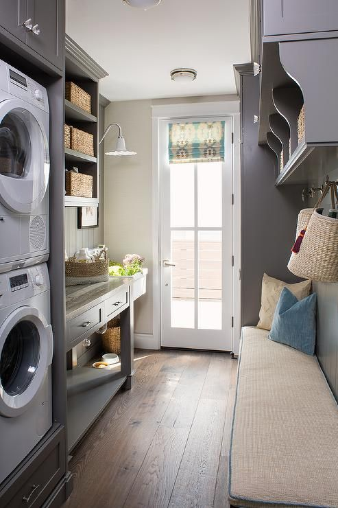 Gray Galley Style Mudroom And Laundry Room Combo Boasting Stacked Washer And Dryer In Gray Built In Grey Laundry Rooms Mudroom Laundry Room Pantry Laundry Room