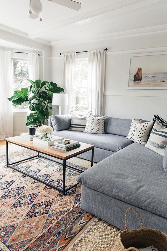 Living Room   White Living Room   Gray Couch   White Curtains   Vintage Rug   Industrial Coffee Table   Fiddle Fig   Ocean Art