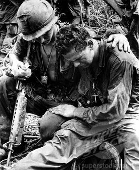 Two soldiers comfort each other under the strain of combat in Pleiku, South Vietnam, 5/26/67. (4048-2095 / hbdviwa_cs005_h © Everett Collection)