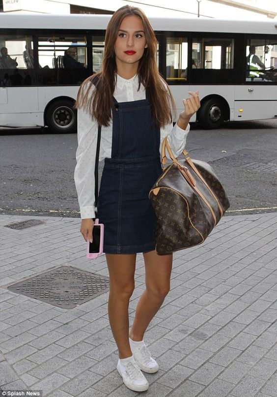Pretty and preppy: The 25-year-old reality star - who went public with her hunky man in Ma...