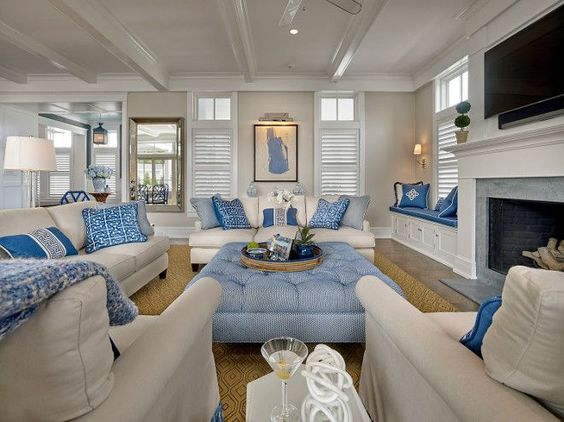 Crisp white trim and neutral walls work beautifully with the blue and white furniture in this living room