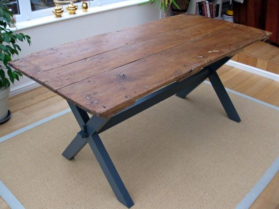 Old barn door turned into dining table repurposing for Upcycled dining table