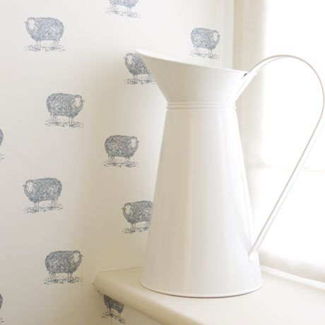 Emily Bond sheep print wallpaper with white jug in foreground