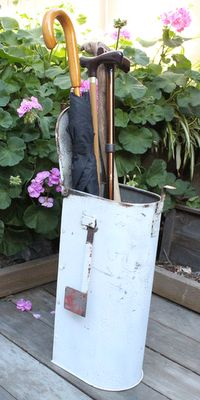A vintage metal mailbox repurposed into an umbrella stand! Upcycle, Recycle, Salvage! For ideas and goods shop at Estate ReSale ReDesign, Bonita Springs, FL