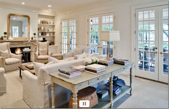 Love the layout and windows. Also really like the sofa table and the width. Would prefer more color.