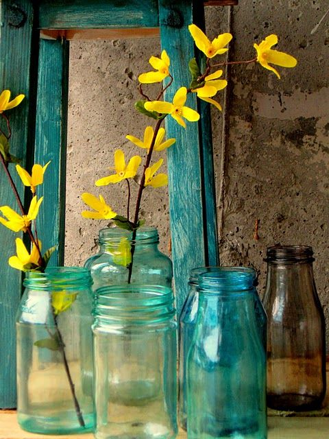 blue mason jars and yellow flowers