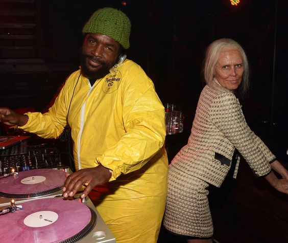 """Dressed in a """"Breaking Bad"""" hazmat suit, Questlove of the Roots parties with a naughty grandma, aka Heidi Klum, during Klum's 14th annual Halloween party on Oct. 31 in New York"""