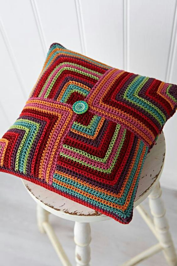 Crochet Cushion Cover. Does not link to a pattern. : (     Looks like four mitered crochet squares sewn together, though. Super cute.