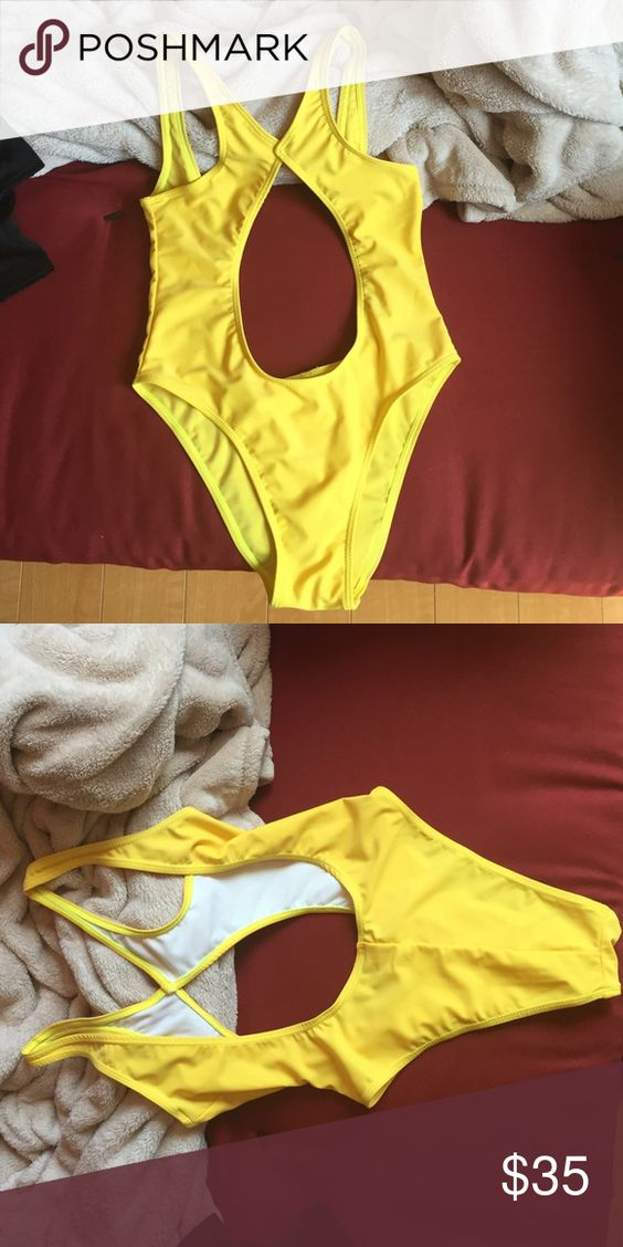 Yellow cut out bikini Yellow cut out bikini NWT. One tag says small and the other says medium but it fits like a small and runs small so it didn't fit me. Perfect condition Swim One Pieces