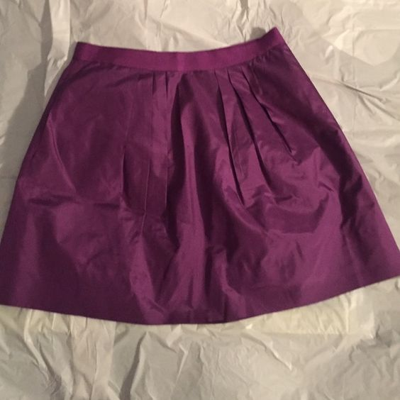 J. Crew ADORABLE Purple Silk/Taffeta Skirt size 2 Great for work or play! Size 2, and with the tulle lining as well, it makes the skirt poof (sp?!) out and be so flattering and forgiving! Not fitted in hips, almost like an exaggerated A-line skirt. It's not knee length but not mini, it's the perfect in between making it work appropriate. I wore with a button down and v neck sweater over it. See pictures and ask questions! Moving Sale!!!! J. Crew Skirts A-Line or Full