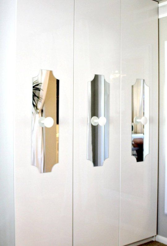 Mary Beth loved the look of the closets in the Viceroy Springs Hotel, and set out to recreate the look with some custom cut mirrors she adhered to the fronts. She later switched out the knobs for something even more special.