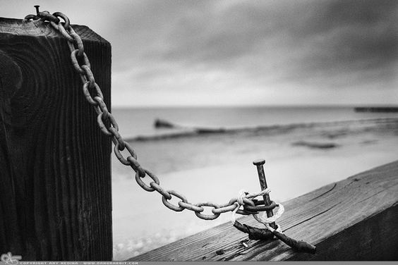 "Picture-A-Day (PAD n.2431) ""Chain Nail""  Rainy and dreary day. Shot this one with Fuji's Acros film simulation and a bit of grain all in camera... prints and more: http://www.dangrabbit.com/photography/pad/03_14_chainnail  Fineart photography nail and chain on Long Island beach in the rain - black and white photo:"