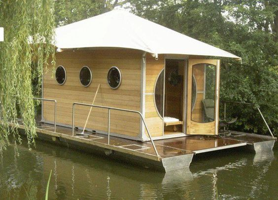 the floating tiny prefab home More@ http://www.cityhomeconstructions.com/house-2/unique-shapes-of-tiny-prefab-homes/