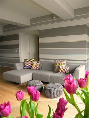 Instead of painting a wall a solid color, add interest with stripes in varying shades of the same color. Horizontal stripes look chic and elongate a room visually. Photo: The Nest: Stripes Wall, Gray Striped Wall, Living Room, Grey Stripes, Striped Walls, Gray Stripes, Accent Wall