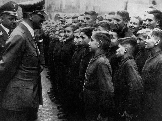 Adolf Hitler welcomes trainees of the Wilhelm Gustloff Foundation at the 'Gautag' (District Day) of the Gau Thuringia in Weimar; following, to his left: the Gauleiter of Thuringia, Fritz Sauckel - 1938