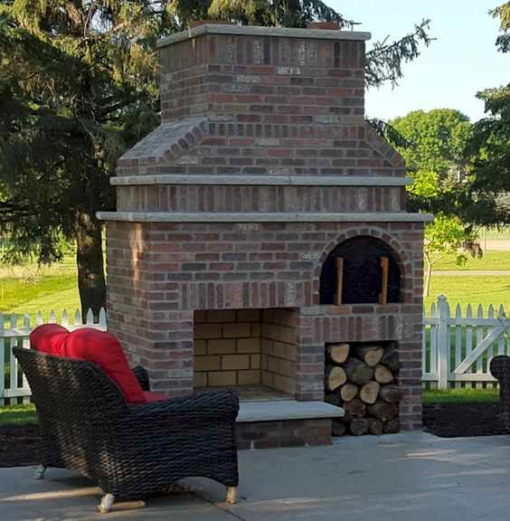 A beautiful outdoor fireplace and wood fired brick pizza for Ramsey fireplace