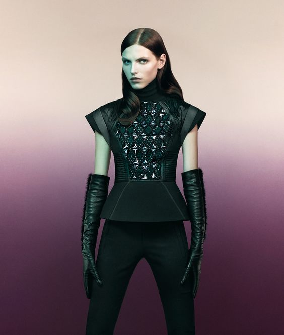 Future Sport – Sportmax taps Karlina Caune for its fall 2012 campaign featuring form-fitting shapes and a color palette of mostly black. Karlina makes an elegant vision in sleek, futuristic looks adorned with fur and leather.
