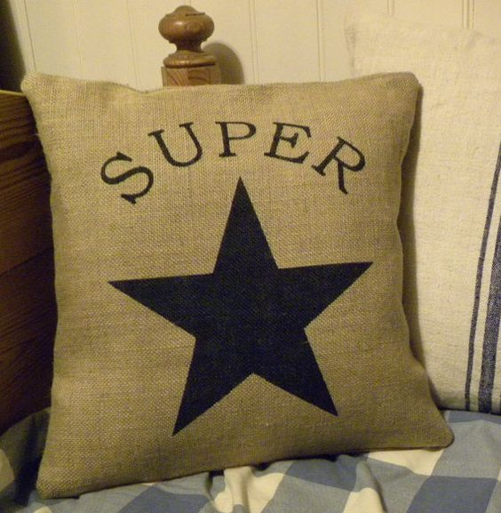 This pillow cover would be perfect for a boys room with the lettering and star painted in a dark navy colour. This would also look great with red