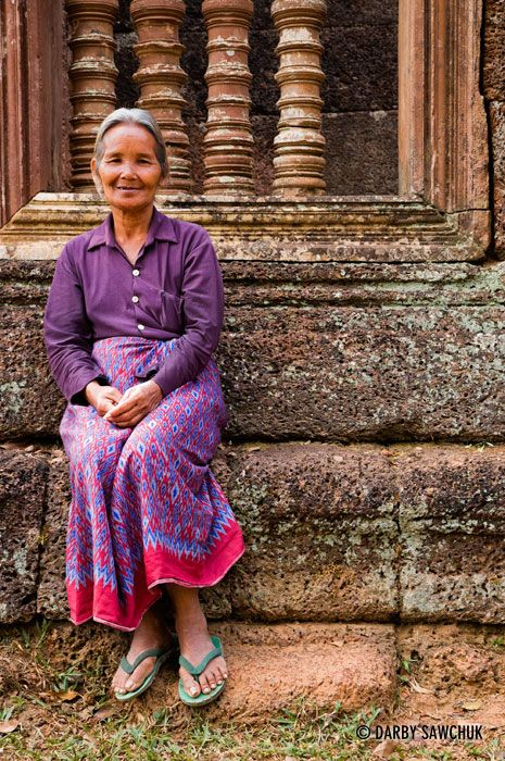 A Cambodian woman sits at Banteay Srei temple near Angkor Wat in Cambodia.༺ ♠ ŦƶȠ ♠ ༻