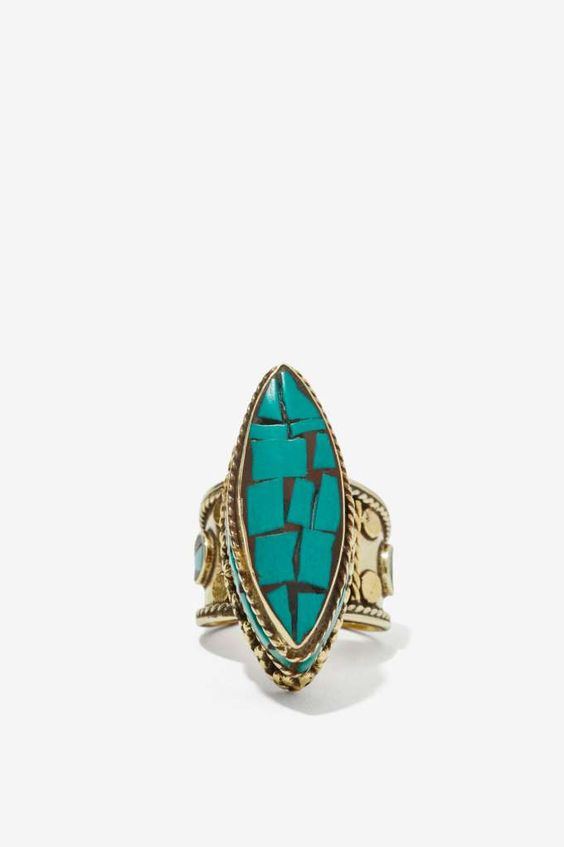 From St Xavier - brass ring with natural turquoise stones, embossing detail, and 3D silhouette. Killer with all things denim, or a lace maxi and vintage boots.