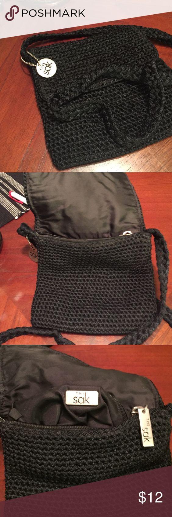 "The Sak cross shoulder purse Really cute black cross body Sak purse. 7"" height, 7"" width, strap 12"" long. The Sak Bags Crossbody Bags"