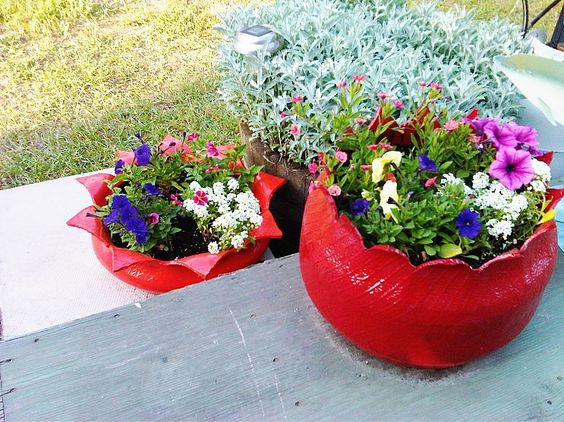 Tire Flower Planters      Create a flower planter from an old tire!        My future father-in-law came up with this brilliant idea over 20 years ago to cut and flip an old tire inside out and use it as a gorgeous planter!
