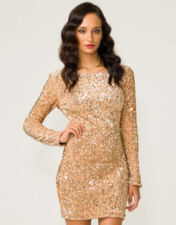 Show stopping glitzy dress featuring all over metallic gold ...